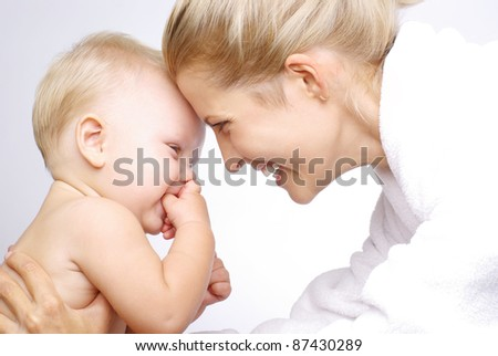 Happy mother with baby boy over white - stock photo