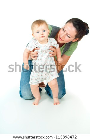 happy mother with baby on a white background - stock photo