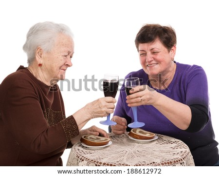 Happy mother with daughter drinking wine on a white background
