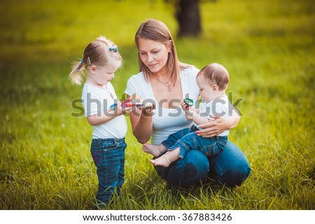 Happy mother with daughters - stock photo