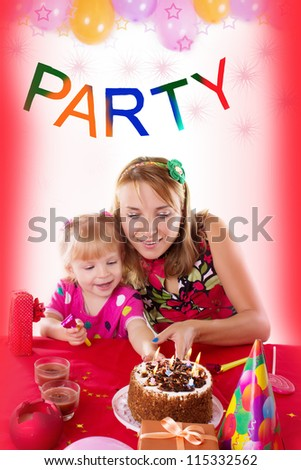 Happy mother with her baby girl celebrating birthday with candles - stock photo