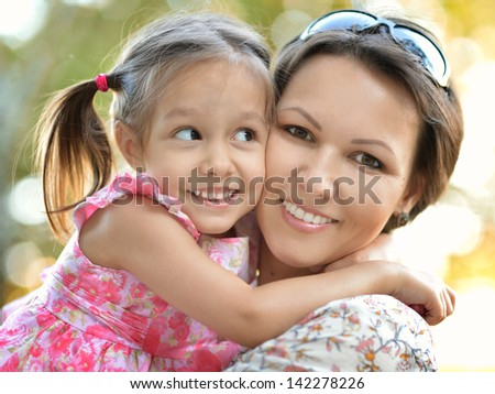 happy mother with her daughter for a walk - stock photo