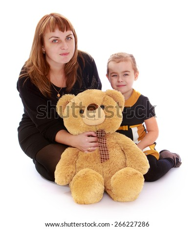 Happy mother with her little daughter and teddy bear. - isolated on white background