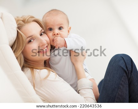 Happy mother with her 6 month old son. - stock photo