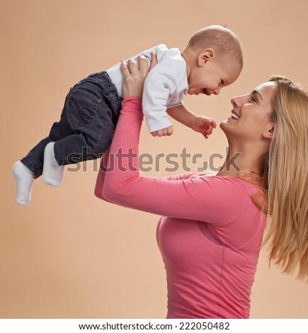 Happy mother with her 6 months old son. - stock photo