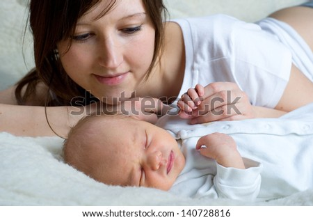 Happy mother with her newborn baby