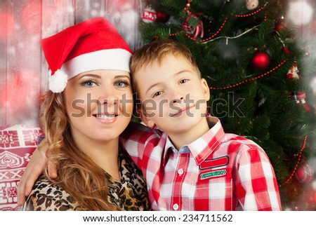 Happy mother with her son during Christmas time