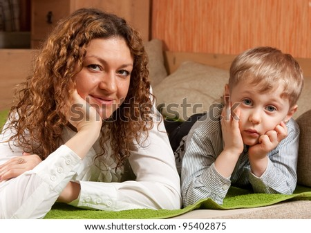 Happy mother with her son  in interior