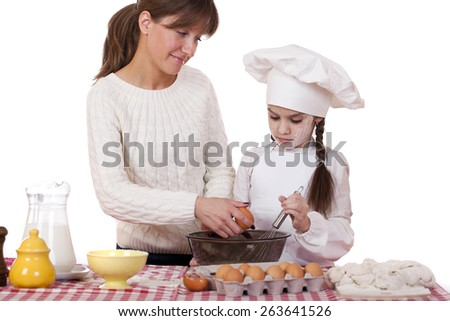 Happy mother with little daughter joyful cooking, isolated on white background - stock photo