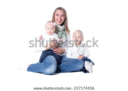 Happy mother with two children: a son and a daughter. Isolated on white background - stock photo