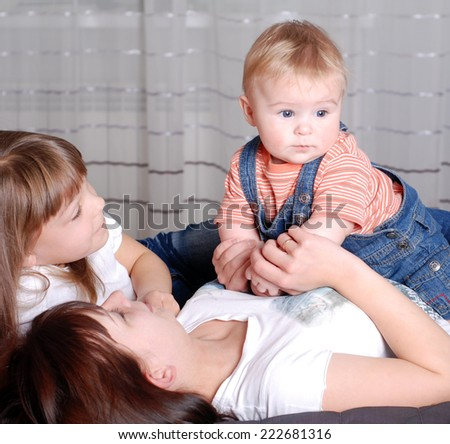 happy mother with two children,brother and sister,happy family - stock photo