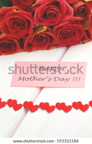 happy mothers day and bouquet of gorgeous red roses - stock photo