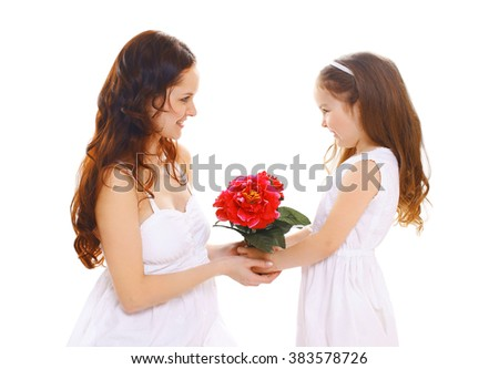 Happy mothers day, birthday and family concept - daughter gives flowers mother - stock photo