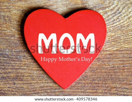 Happy Mothers Day decorative red heart on wooden background. Mother`s day background. - stock photo