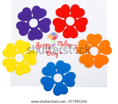 Happy Mothers Day message written on paper and decorative flowers isolated on white - stock photo
