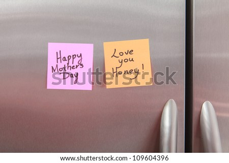 Happy Mothers Day Post It Note on a home kitchen refrigerator.