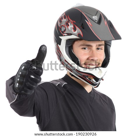 Happy motorcyclist man gesturing thumbs up isolated on a white background    - stock photo