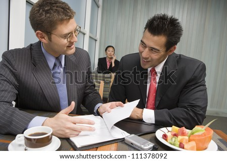 Happy multi ethnic business people discussing contract