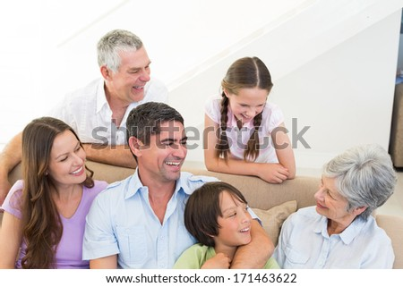 Happy multi-generation family at home - stock photo