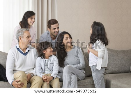 Happy multi-generation family sitting on sofa