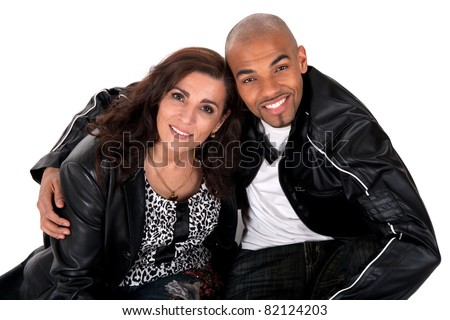 Happy multicultural couple smiling. Mature woman with younger man.