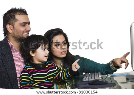happy multiethnic family of three enjoying together, happy mother and father teaching their son on computer