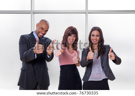 Happy multiracial business team going thumbs up.