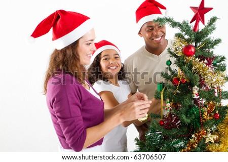 happy multiracial family decorating Christmas tree - stock photo