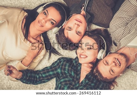 Happy multiracial friends listens music - stock photo