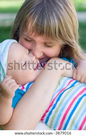 Happy Mummy hug her little son - stock photo