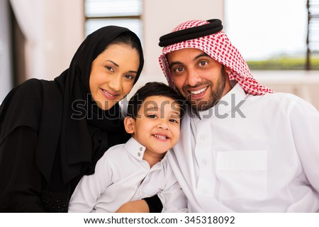 happy muslim family spending time together at home - stock photo