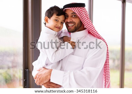 happy muslim father and son indoors - stock photo