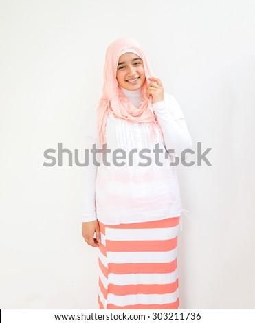 Happy Muslim girl on summer vacation - stock photo