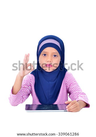 happy muslim girl with tablet isolated on white - stock photo