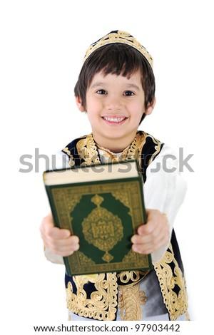 Happy muslim kid holding holy Quran - stock photo