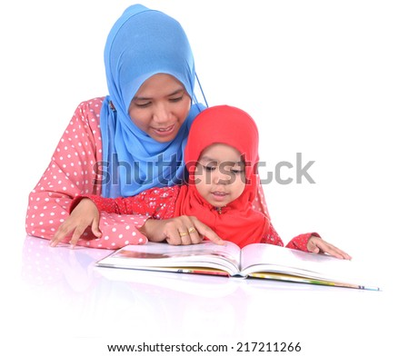 happy Muslim mother and child reading a book together. White background - stock photo