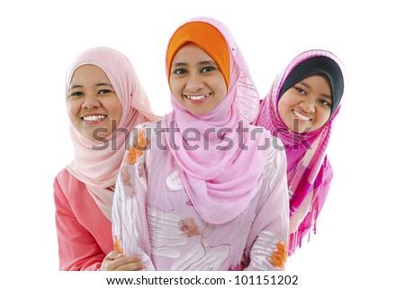 Happy Muslim women standing in row, on white background - stock photo