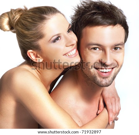 Happy naked couple hugging - stock photo
