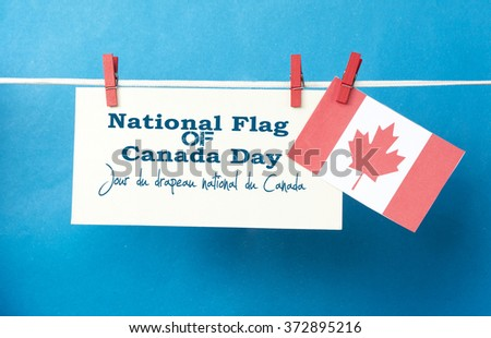 Happy National Flag of Canada Day  on French Jour du drapeau national du Canada. is observed annually on February 15. envelope Card with Canadian flag on clothespin (peg).