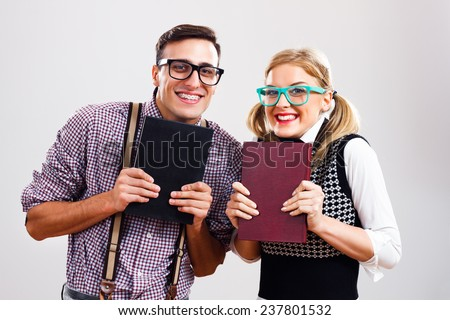 Happy nerdy man and woman  are very excited because of learning,We love to learn! - stock photo