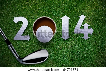 Happy New Golf year 2014,  Golf ball and putter on green grass, the same concept available for 2015, 2016 and 2017 year. - stock photo