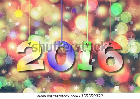 Happy New Year 2016. Abstract blurry background with colorful hanging inscription 2016 years.
