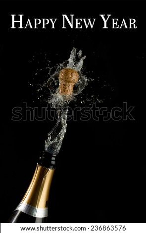 Happy new year against champagne cork popping