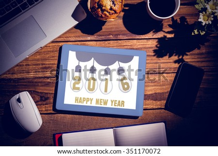 Happy New Year against view of a desk