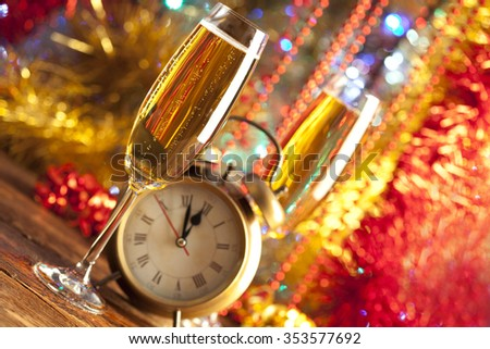 Happy new year - alarm clock and champagne - stock photo
