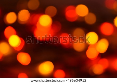 Happy new year and christmas background. Christmas lights blurred. Orange and gold abstract dots background. Party pattern. Bokeh effect.