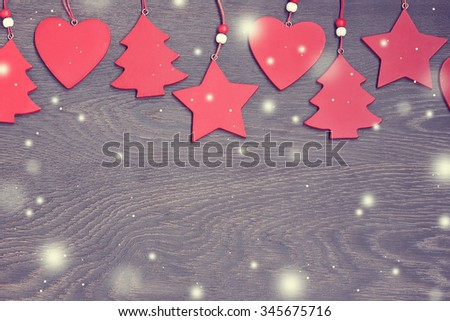 Happy New year and Merry Christmas! New Year's background. Red decorative Christmas-tree decorations on a wooden background. A blank space for your text. Card, congratulation, invitation. - stock photo