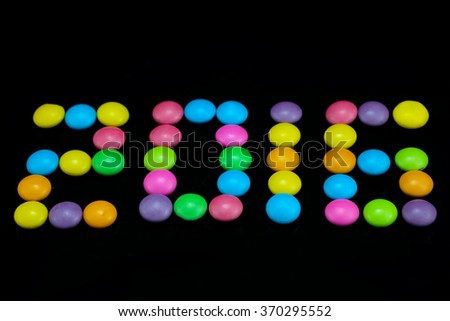 Happy New Year 2016 arranged from Chocolate candy on black background