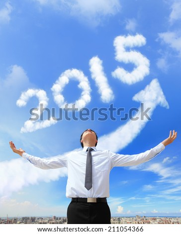 happy new year 2015, Business man hug 2015 (white arrow cloud and blue sky on sunny day) - stock photo