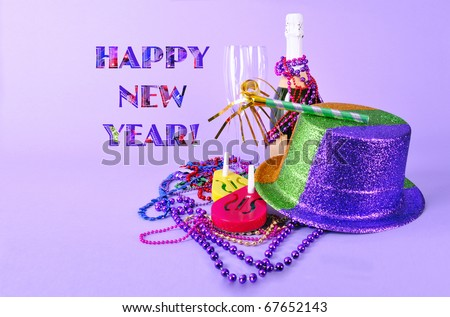 Happy New Year card party invitation New Years Eve 2012 still life with champagne bottle and flutes, noisemakers, party hat, and beads on purple background